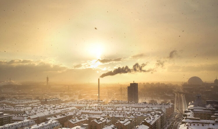 Drone flying over a factory in a polluted atmosphere