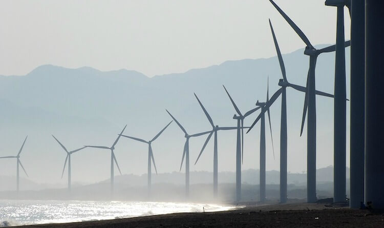 Wind farm along a sandy beach